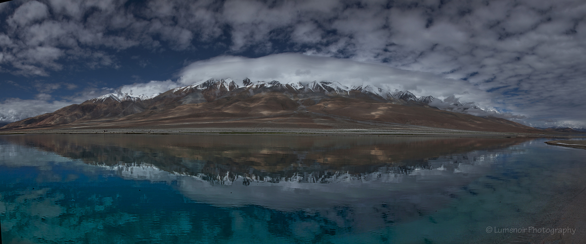 A shore of Pangong Tso seen from the water.